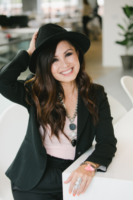 kalika yap wearing black hat