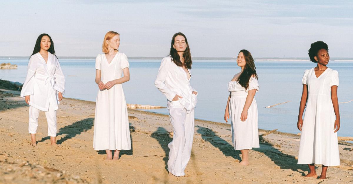 image women wearing white dresses for orange and bergamot