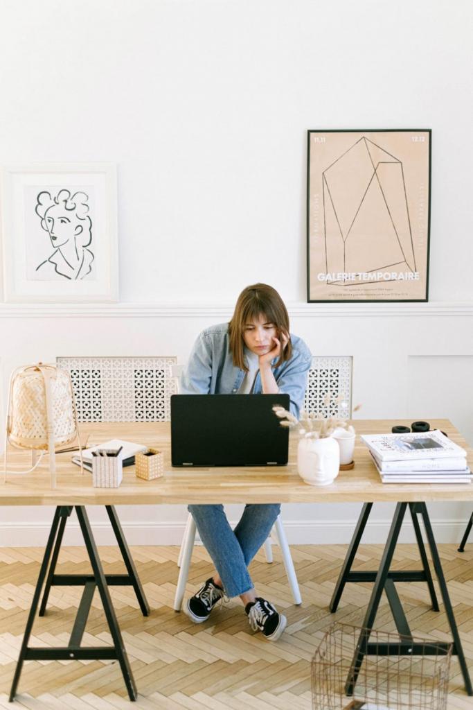Bored woman looking at laptop image for orange & bergamot